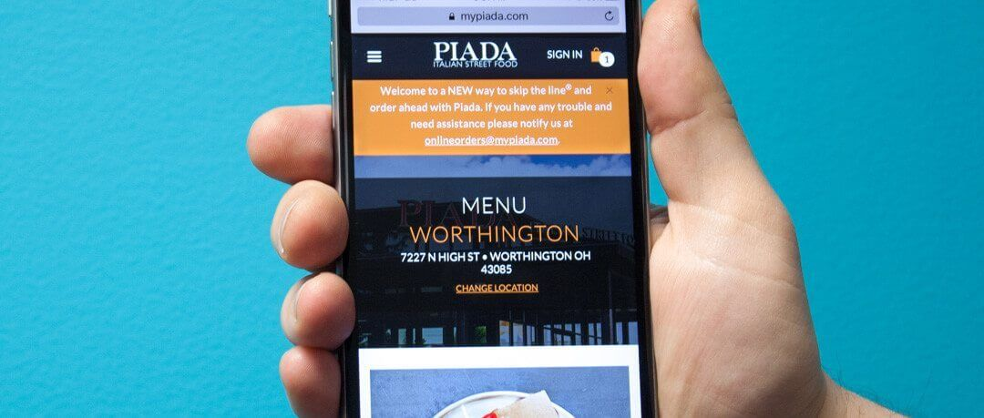 Photo of Piada's mobile responsive online ordering process on an iPhone