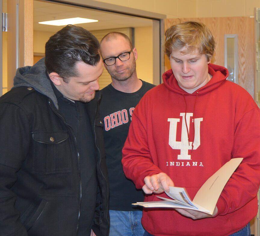 FIRST FRC Team 4611 Steve Schwinghammer, Rory Schmidt examining brochure