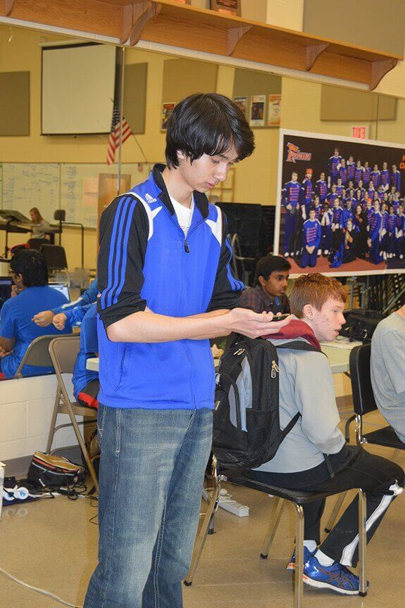 FIRST FRC Team 4611 student directing the robot