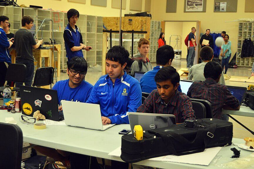 FIRST FRC Team 4611 members working on the robot's software