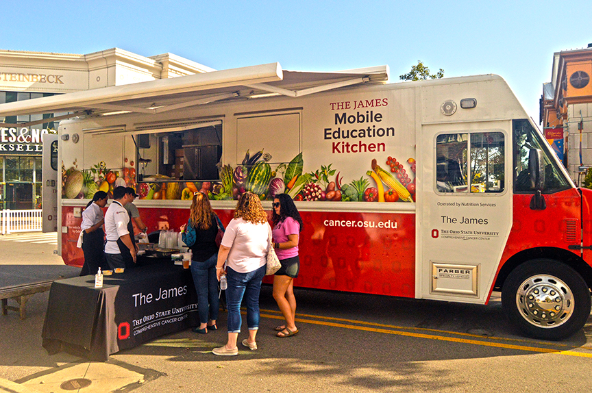 The James information truck surrounded by guests
