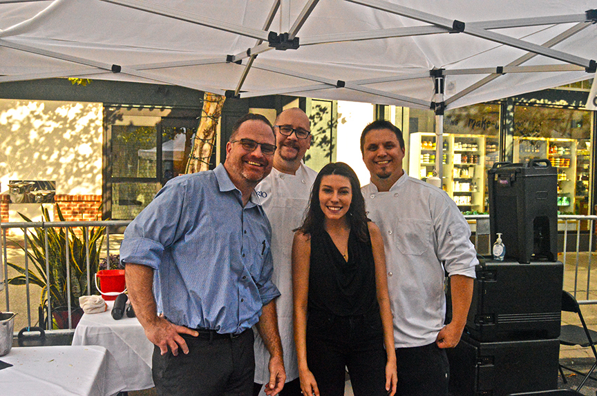 Three restaurant men and a woman posing at 2019 Mac and Cheese fest