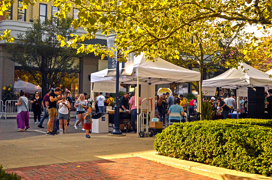 Behind tent shot of vendors with crowd at 2019 Columbus Mac and Cheese Festival