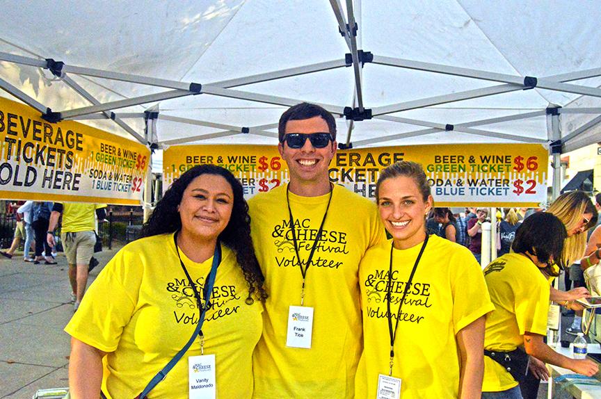 Three ambassadors in yellow shirts at festival