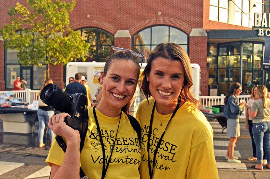 Two women NextGen james Ambassadors pose with camera in hand