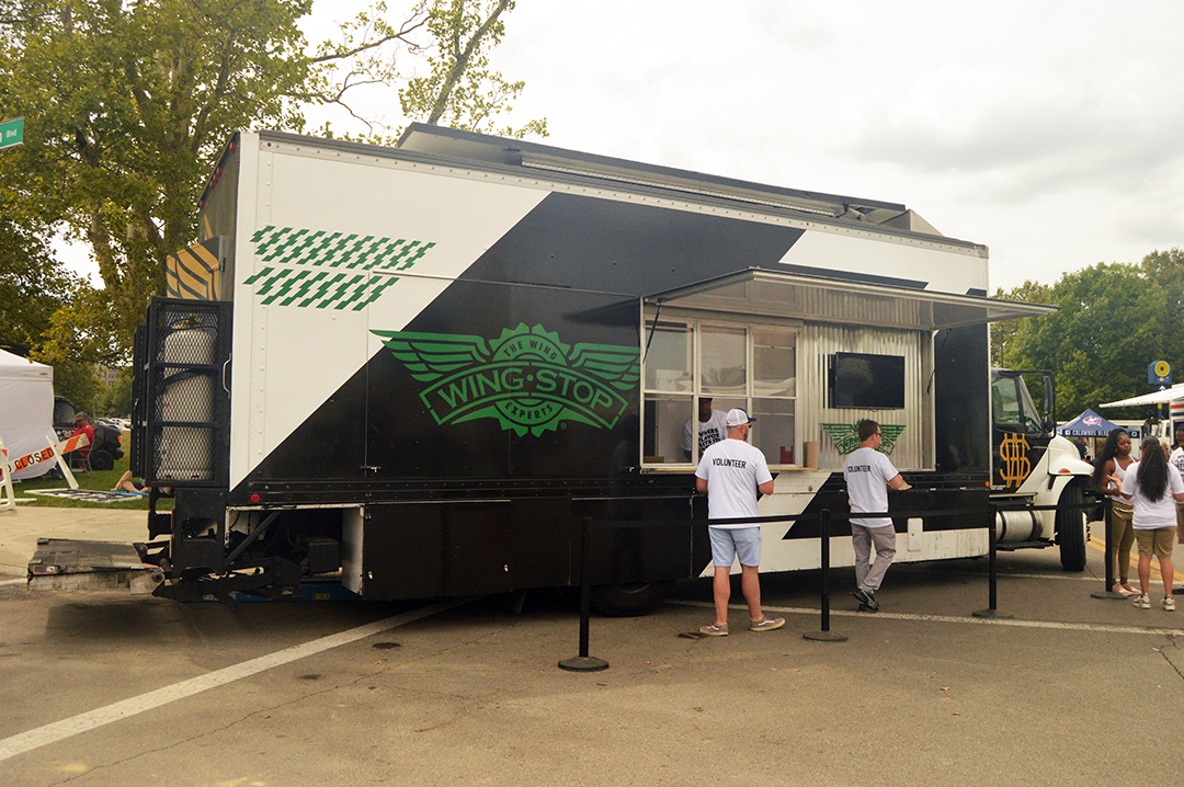 Two patrons ordering from WingStop, Columbus Food Truck Festival