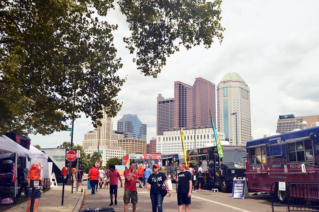 Street shot with patrons with city behind, Columbus Food Truck Festival