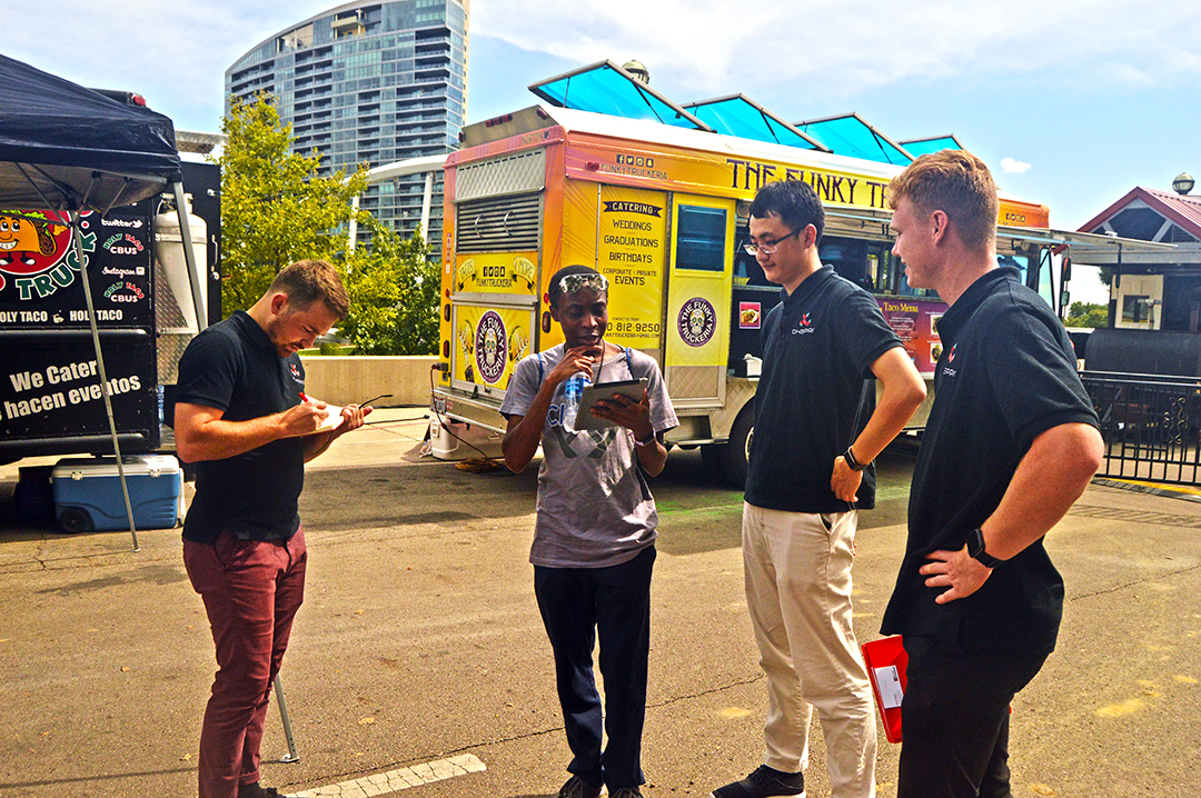 Three members of the Chepri team conducting usability study with patron at Columbus Food Truck Festival