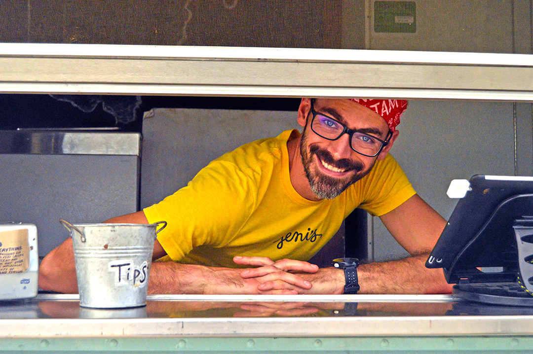 Proprietor in yellow shirt says hello from the Jeni's Ice Cream Food Truck
